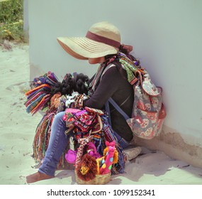 Woman sales souvenirs on a tropical beach.