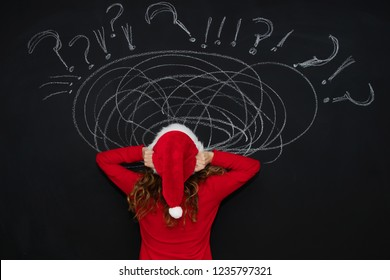 woman with santa claus hat and expression of problems and stress at christmas