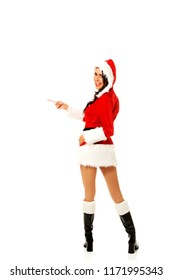 Woman in santa costume pointing to the left