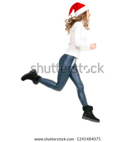 b0c1b1b2bb4 Woman with santa hat goes walking runs jumping on white background  isolation back view