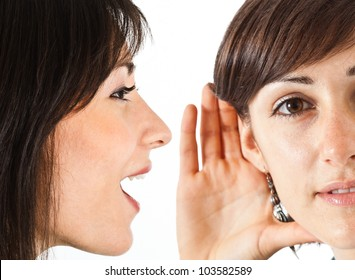 Woman saying a gossip to a friend
