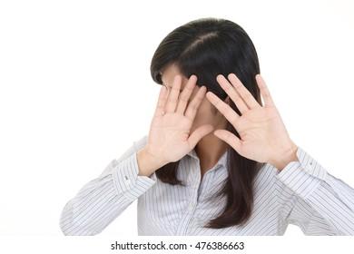 Woman saying no photos