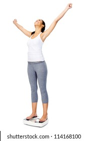 Woman with scale celebrating weightloss and a healthy fit body
