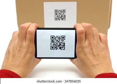 Woman scan qr code on box