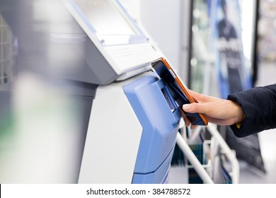 Woman scanning via mobile phone and machine