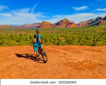 Woman at a Scenic Point on Mountain Bike