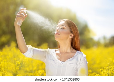 Woman with scented body spray cosmetic beauty skin care concept. Perfume and refreshment
