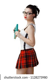 Woman in a schoolgirl costume and black glasses for reading holds the book in his hands. Isolated on white background