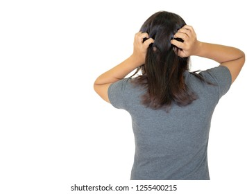 woman scratching her head.