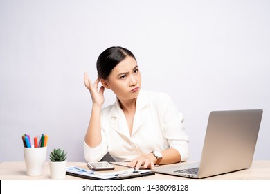Woman scratching her head at office isolated white background