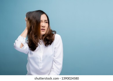 Woman scratching her head on background