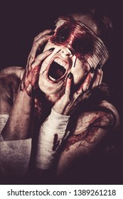Woman screaming with bloody eyes