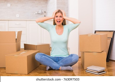 Woman screaming in panic because of too much things to do while moving into new home.