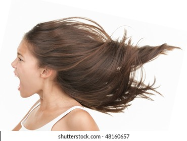 Woman screaming / shouting. Angry and upset beautiful young mixed race asian / caucasian woman in profile. Isolated on white background