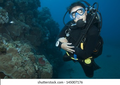 woman Scuba diver in blue ocean