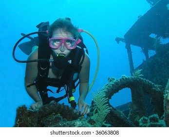 Woman scuba diver on a ship wreck dive site