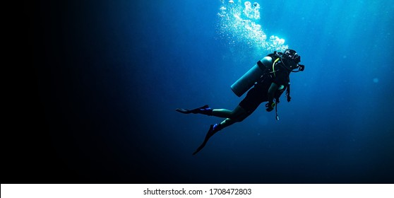 Woman scuba diving in deep blue sea banner on black background