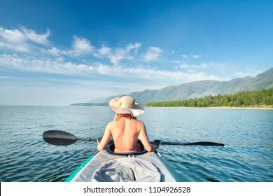 A woman in a sea kayak on Lake Baikal