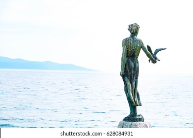 Woman with the seagull statue