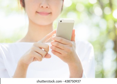 Woman to search for in the smartphone , mobilephone, cellphone, fresh green