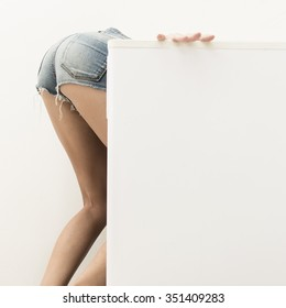 woman searching food in the fridge showing her ass and legs
