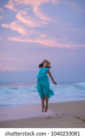 Woman at the seashore of Indian ocean after sunset