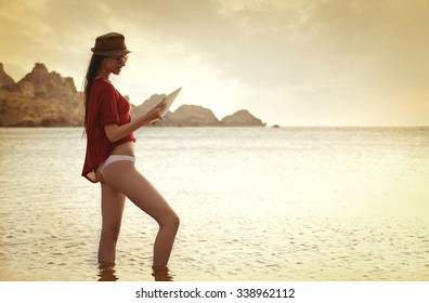 Woman at the seaside with a tablet