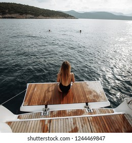 Woman seat on the yacht in the sea