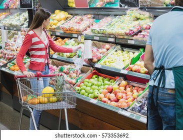 Woman selecting her fruits and vegetables on a grocery