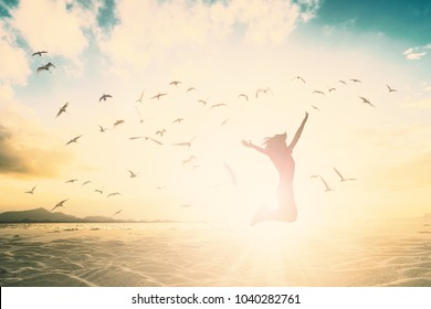 Woman self confidence jump on beach sunset time concept for happy relax life wellbeing, motivate inspiration reborn in easter day, ramadan