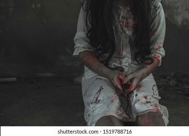 Woman self harming with knife. Woman hand holding knife. Halloween concept. Horror and Scary concept.