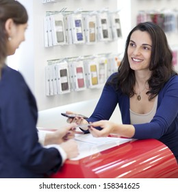 Woman selling a cellular phone