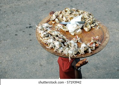 Woman selling crab meat on the street in africa