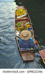 Woman selling fruits at Damnoen Saduak Floating Market, Bangkok, Ratchaburi, Thailand