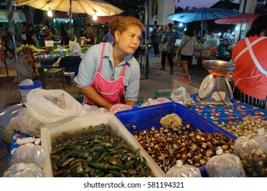 woman selling shells at the market by Bangsaray Pattaya Chonburi Thailand February 2017