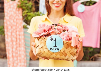 woman selling things on a garage sale