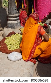 Woman selling vegetables in the market of  Jaipur, Rajasthan, India
