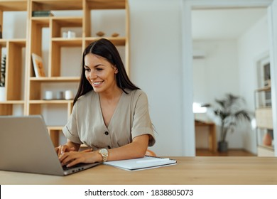 Woman sending an email to someone.