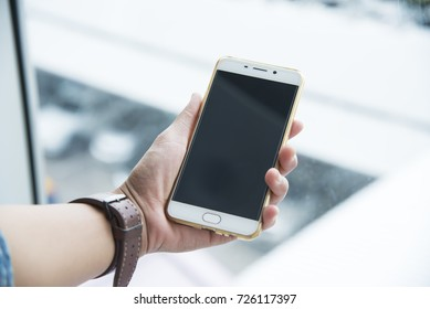 Woman sending message on smartphone ,touching smartphone screen