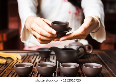 Woman serving Chinese tea in a traditional tea ceremony