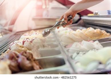 Woman serving ice cream in Confectionery shop