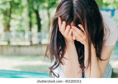 woman with severe headache with fraud on the city