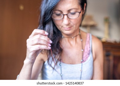 Woman sewing up a fabric by hand.