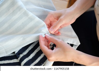 Woman sewing a skirt