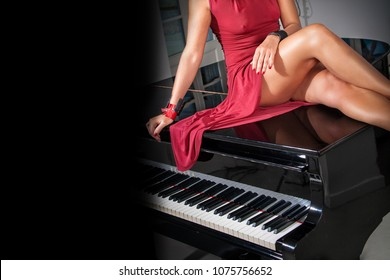 woman with sexy legs and red dress sitting on black grand piano with space for your text