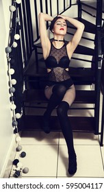Woman in sexy Lingerie on stairs