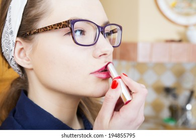 Woman at sexy suit stains pink upper lip