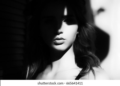 woman with shadows on face