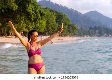Woman shape beautiful in bikini at beach Koh Chang Thailand.