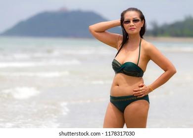 Woman shape pretty with bikini on water the beach Tap Skea, Prachuap Khirikhan Province Thailand